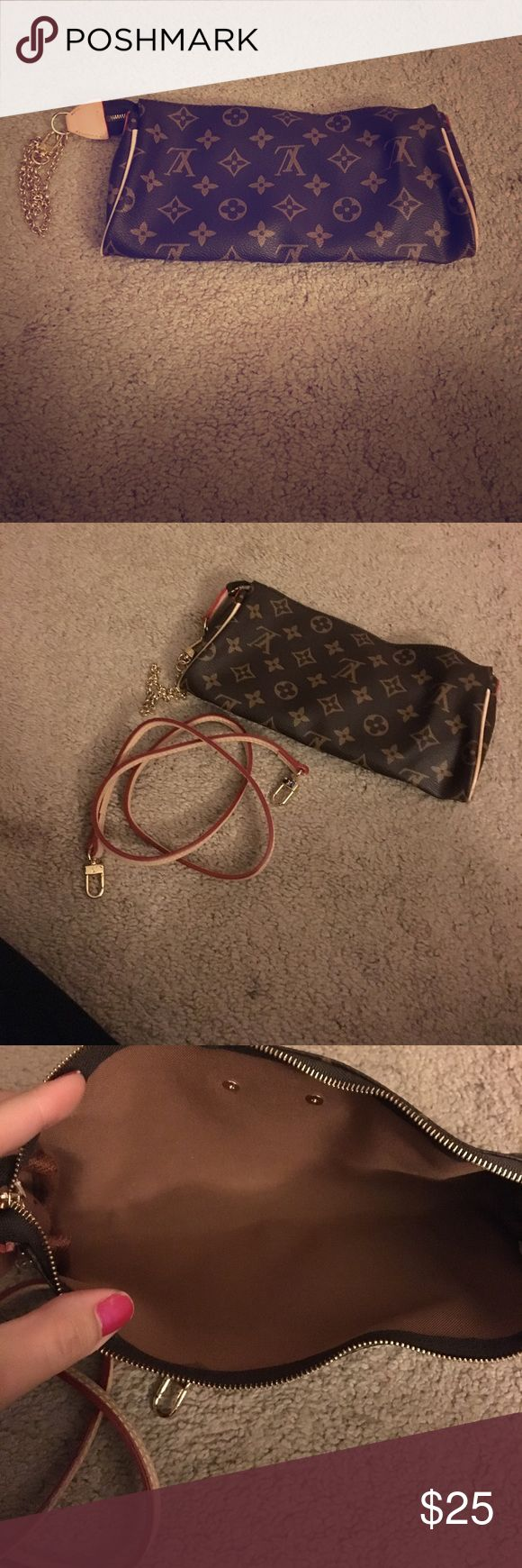 NOT REAL Louis Vuitton clutch/hand bag It may not be real but it's one hell of a knock off and I've never used it! Someone needs to!! Bags