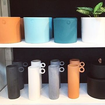 A rare pop of colour  Our minimalist pots and loop vases in terracotta + shades of forest and sky play back nicely against black and concrete staples! These guys are on the site now as well as through selected stockists #handmade #colourpop #minimalist