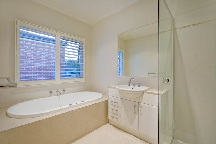 This appealing luxury bathroom is a beautiful addition to any custom built home. Showing simple is charming.