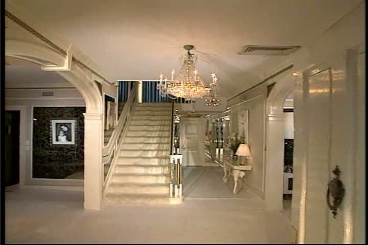 Super rare! This is the only picture I have ever seen of Graceland decorated in all white. This is taken from the front door. It's exactly what you see as soon as you walk in. Dining room on left, staircase, living room on right. Down the hallway to the right was Vernon & Gladys' bedroom. The door at the end of the hall is a closet