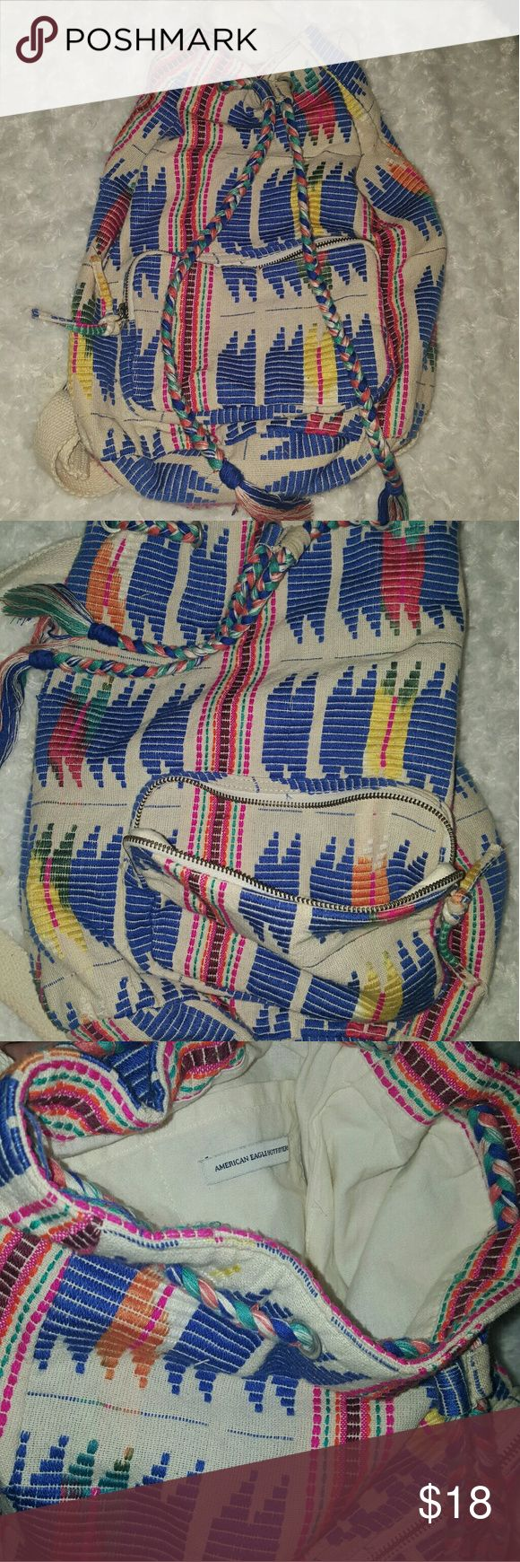 American Eagle Drawstring Backpack Bag Multicolored American Eagle drawstring backpack bag. Has one zipper pocket in the front and adjustable straps on the back. Lightweight. In good condition. American Eagle Outfitters Bags Backpacks