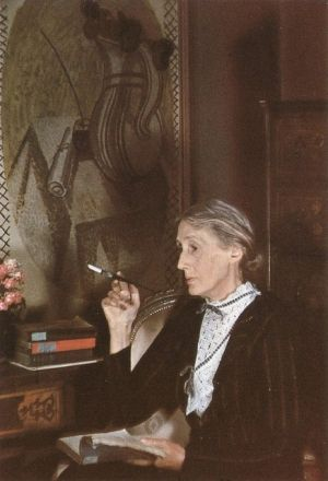 Virginia Woolf reading-with a cigarette holder. That's of such a time. Note: we think she was young when she walked into the river because of Nicole Kidman. Not so much.
