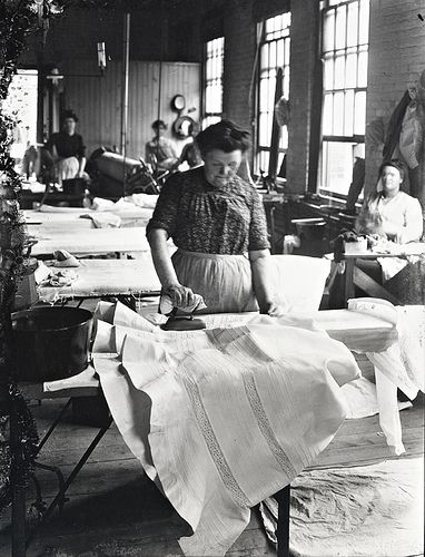 MP-1985.31.179  Woman ironing a starched petticoat, M. T. S., QC, about 1901  N. M. Hinshelwood  About 1901, 19th century or 20th century  Notman photographic Archives - McCord Museum