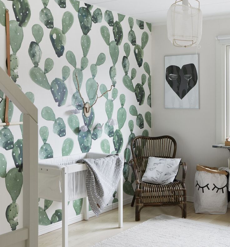 Beautiful nursery with punch! Love the cactus walls, the sleeping hamper and the offbeat heart. #estella #nursery #decor
