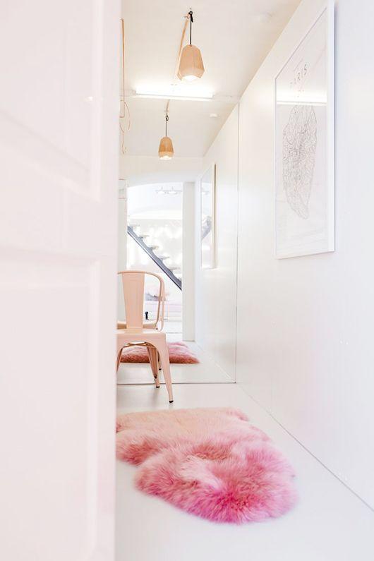 Pink sheep skin and fun hallway styling.