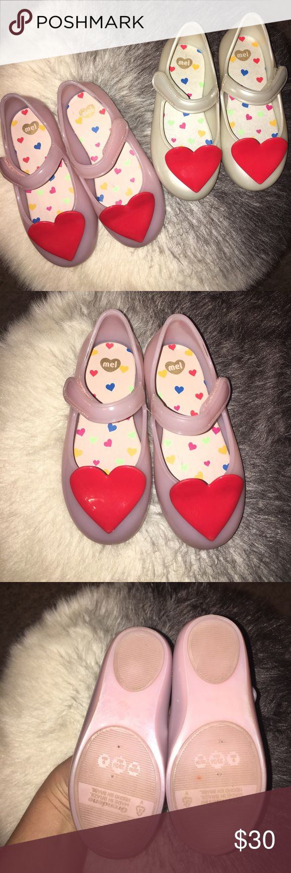 Set of 2 MINI MELLISA shoes! Selling these as a set 2 mini Melissa shoes. They smell amazing!! Perfect condition my daughter wore these at the most 3 times. Both are size 9. Comes from smoke free and pet free home! Mini Melissa Shoes Dress Shoes