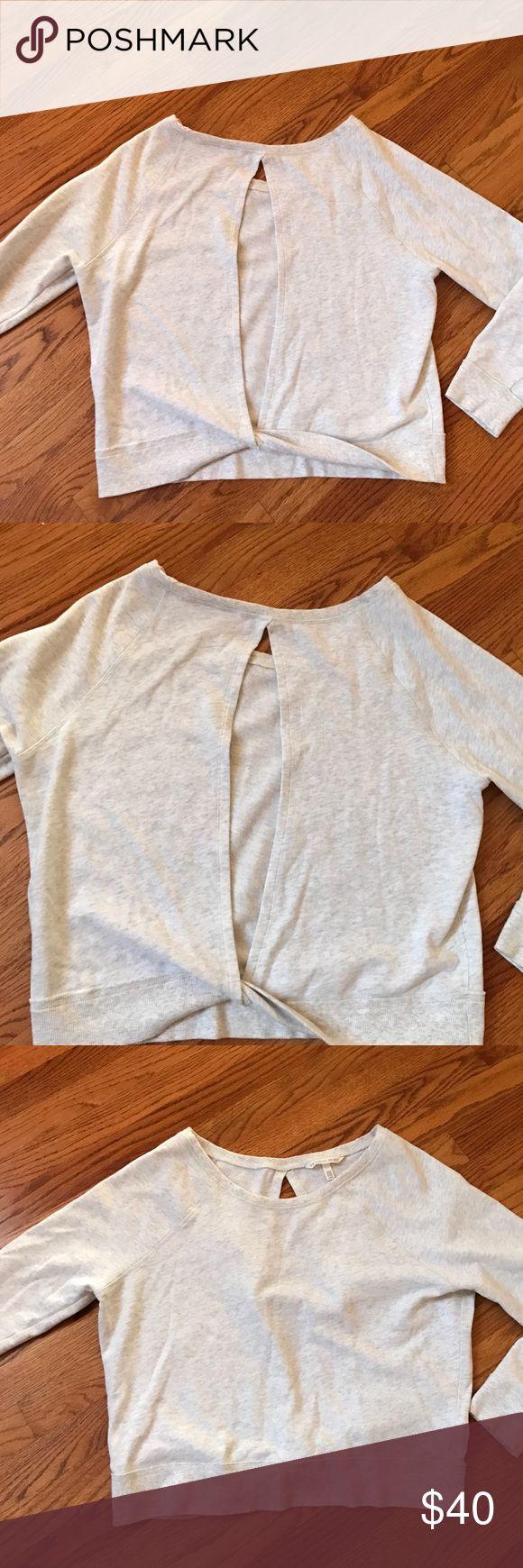 Victoria secret key hole open back sweatshirt Victoria secret key hole open back sweatshirt no stains in light grey super soft inside scoop neck Victoria's Secret Tops Sweatshirts & Hoodies