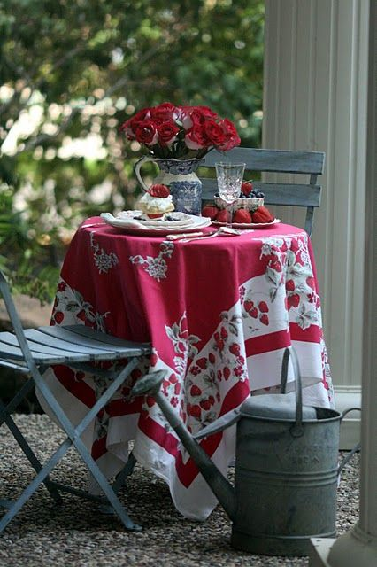 Tea time. I adore this tablecloth, and watering can.