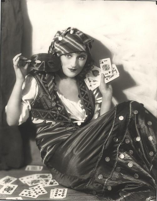 Carmel Myers as a gypsy fortune teller.
