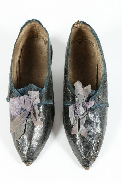 "Pair of women's shoes, c. 1785. Midnight blue morocco leather, trimmed with navy ribbons, low ""italian heel""."