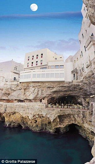 Nestled: The restaurant is built in the cliffs of the Italian medieval town Polignano a Mare