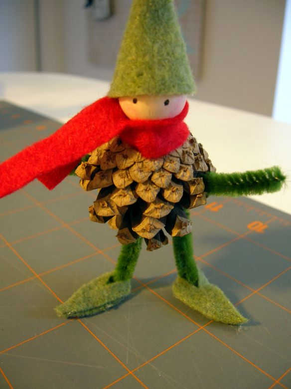 I'm going to have to try this!  Totally adorable pinecone elf …. tree topper for the non-fairy inclined??