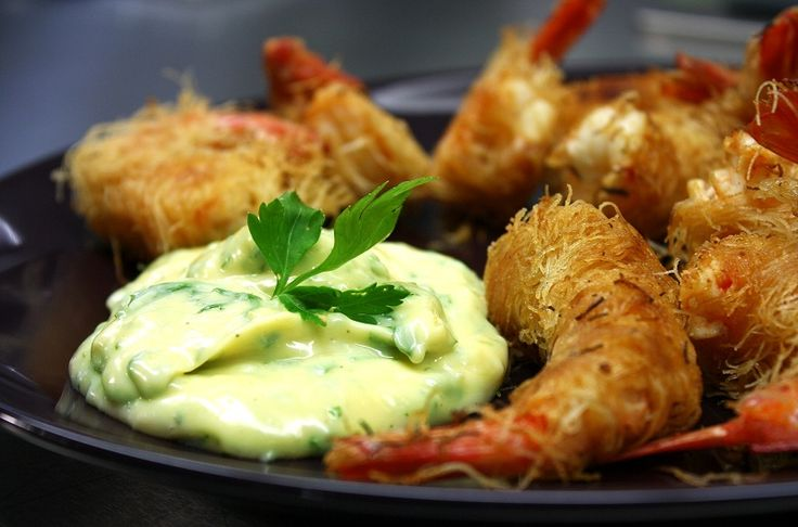 Fried shrimps wrapped in kataifi (shredded phyllo dough) served with aioli sauce (mayonaise with garlic and parsley).