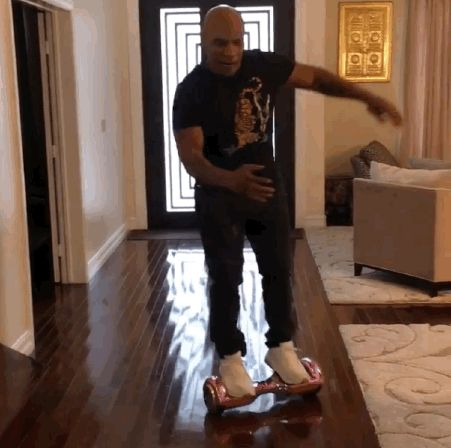 Mike Tyson shared a video of himself falling off a hoverboard.