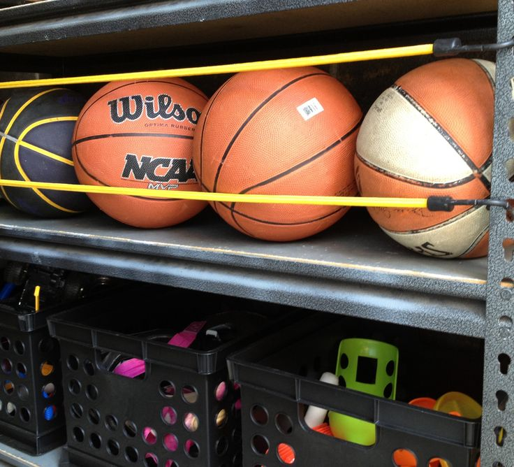 Ball storage with bungees for the garage - much easier access for the kids!