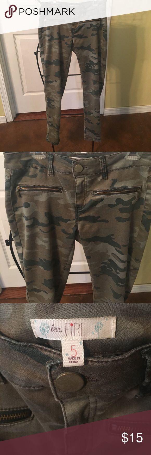 Cute, designer camouflage jeans. Worn once. Cute, designer camouflage jeans with front zipper detail. Worn once. love fire Jeans Skinny