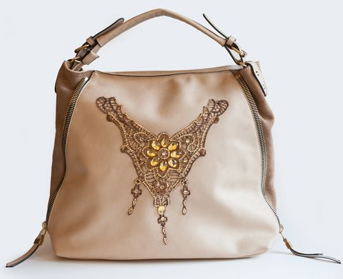Butterfly, stunning and precious light pink shoulderbag with light brown suede details. Adadi Accesories