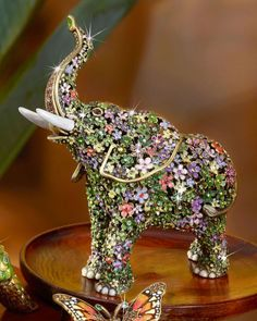 Handcrafted elephant figure. Cast metal. Embellished with hand-applied layers of…