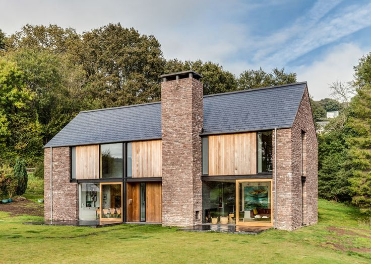 Sandstone-clad house in Wales resembles local barns