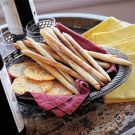 Sage Bread Sticks         2 1/2 tsp. (1 package) active dry yeast      1 cup warm water (105° to 115°F)      3 1/2 to 4 cups unbleached all-purpose flour      2 tsp. salt      2 tsp. dried sage, finely crumbled      1/3 cup olive oil