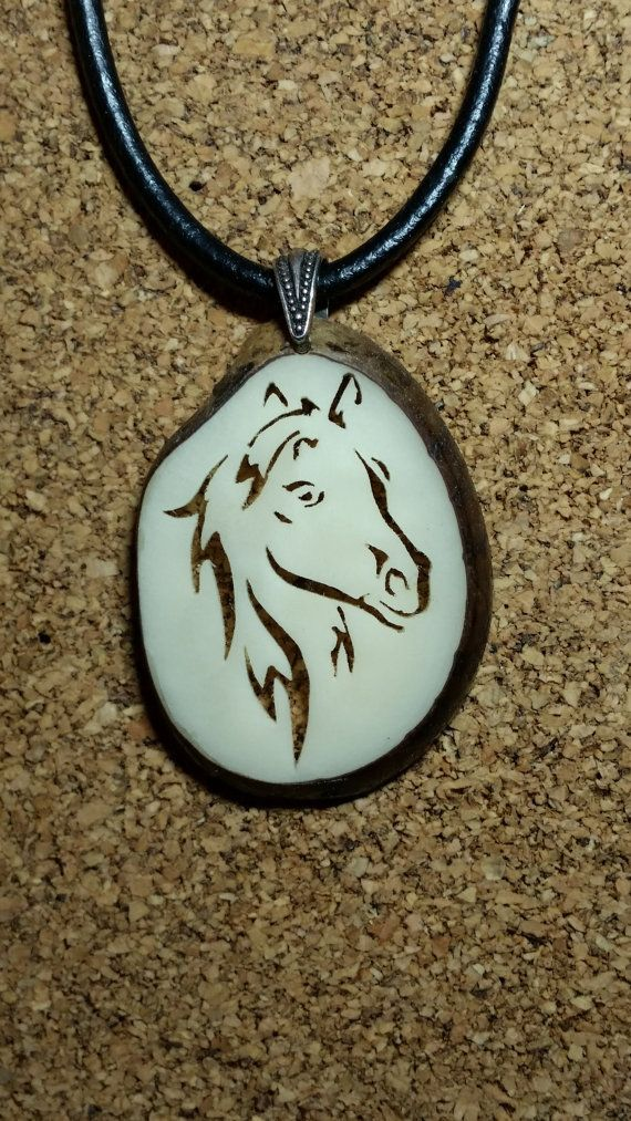 Check out this item in my Etsy shop https://www.etsy.com/listing/219066881/horse-head-tagua-pendant-necklace