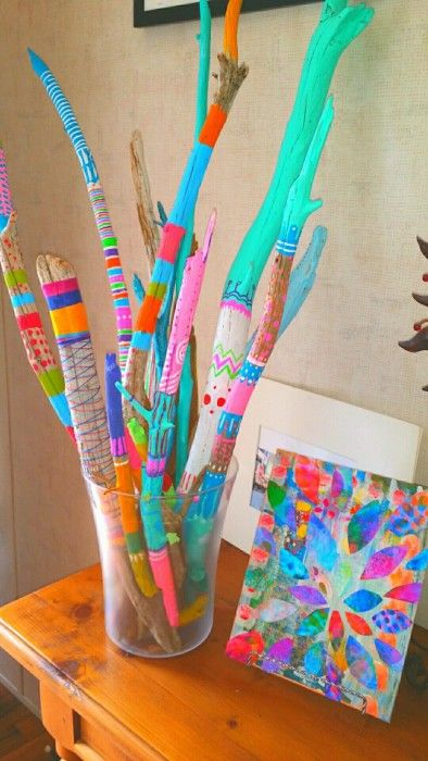Painting sticks in bright colours