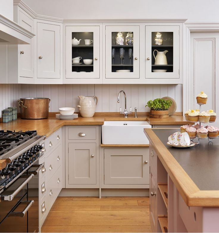 shaker style cabinets in a warm gray with darker gray interior + butcher block counter top