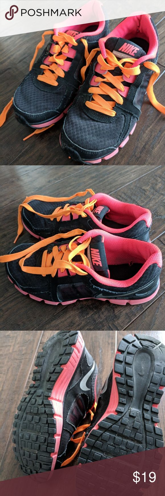 Nike Dual Fusion Sneakers size 7 Gently worn - Black with orange.  Size 7.  Small hole in the lining of the left shoe.  Still have lots of wear left to them... Nike Shoes Athletic Shoes