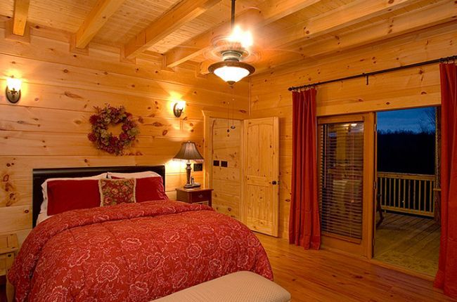 A Rolling River Cabin | Cabin Rentals of Georgia - Main Level Queen Suite with French Doors that Open to Main Covered Porch