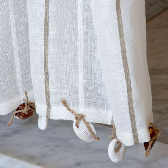 Attach shells on curtains, for weight/decor, or make decorate sheer curtains with shells as seen on Completely Coastal here: http://www.completely-coastal.com/2012/09/sheer-shell-curtains-video-tutorial.html