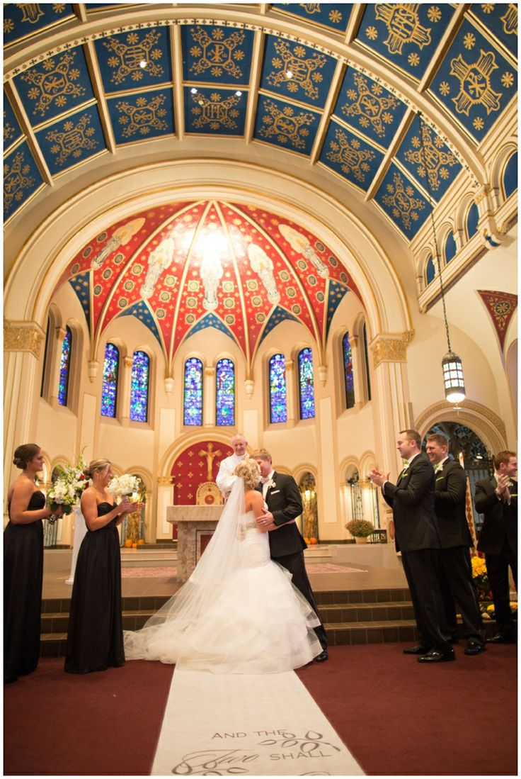 www.5thPhotography.com; Des Moines wedding photographer; wedding photos; St. Ambrose Cathedral; first kiss; wedding ceremony