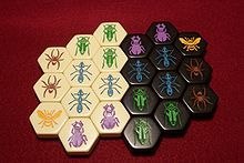 Hive (game) - we just played this at Manuela. such a fun 2-person game, like chess without being restricted to a board. shame there's no way for it to be a 3-4 person game.