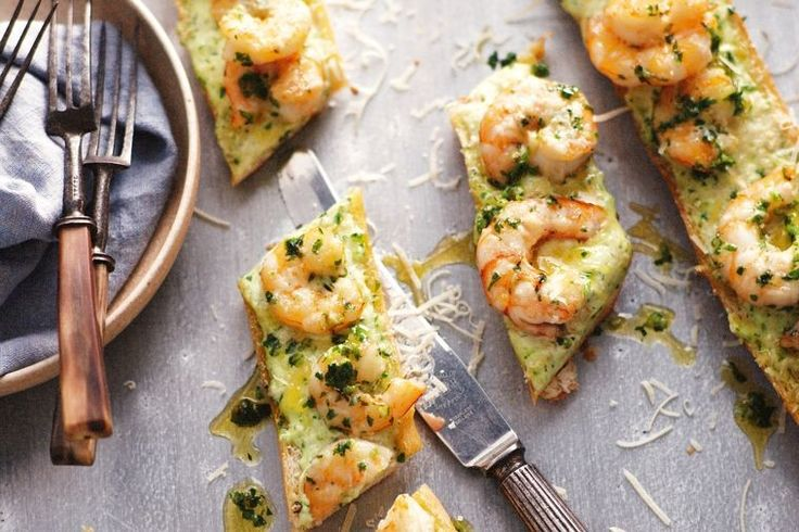 If you're making pizza tonight, why not ditch the tomato base and try this garlic prawn topping instead?