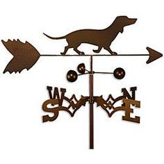 This weathervane is handmade of strong 14-gauge steel with a sealed ball bearing in the wind cups. The weathervane is coated with copper-colored powder coat paint, and features a Dachshund dog.