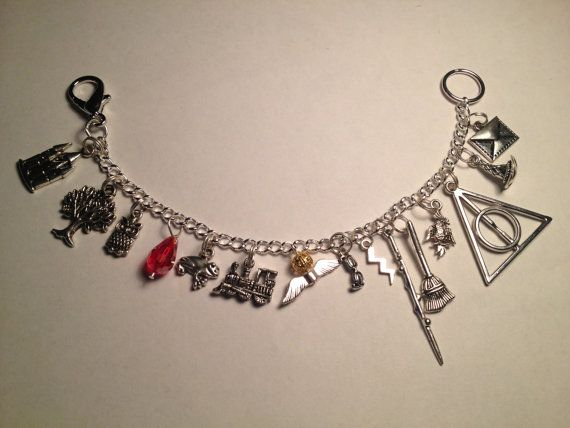 Harry Potter charm bracelet On each bracelet you will get: Hogwarts School A Whomping Willow Hedwig the Owl Philosopher's Stone A Chocolate Frog The Hogwarts Express Train The Golden Snitch Harry's Glasses Harry's Lightning Scar Your very own Wand! Your own Magic Broomstick A Phoenix Deathly Hallows Sorting Hat An Invite Letter to Hogwarts