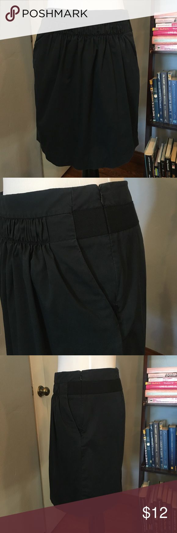 Banana Republic Black Stretch Skirt with Pockets This is such an adorable skirt! It's pedal shaped, meaning it's a looser version of a pencil skirt. Pockets in the front with a fantastic ruching detail across the top. Happy to answer any questions! Banana Republic Skirts