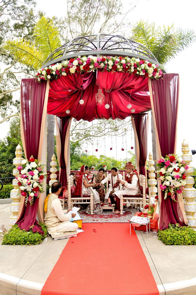 This domed fabric mandap is perfect for an outdoor indian wedding; Add as little or as many flowers as you want around the mandap pillars and on the top of the mandap frame