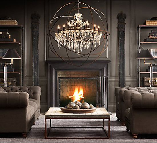 Foucaults orb crystal chandelier large acts as lighting fixture and art piece above fireplace