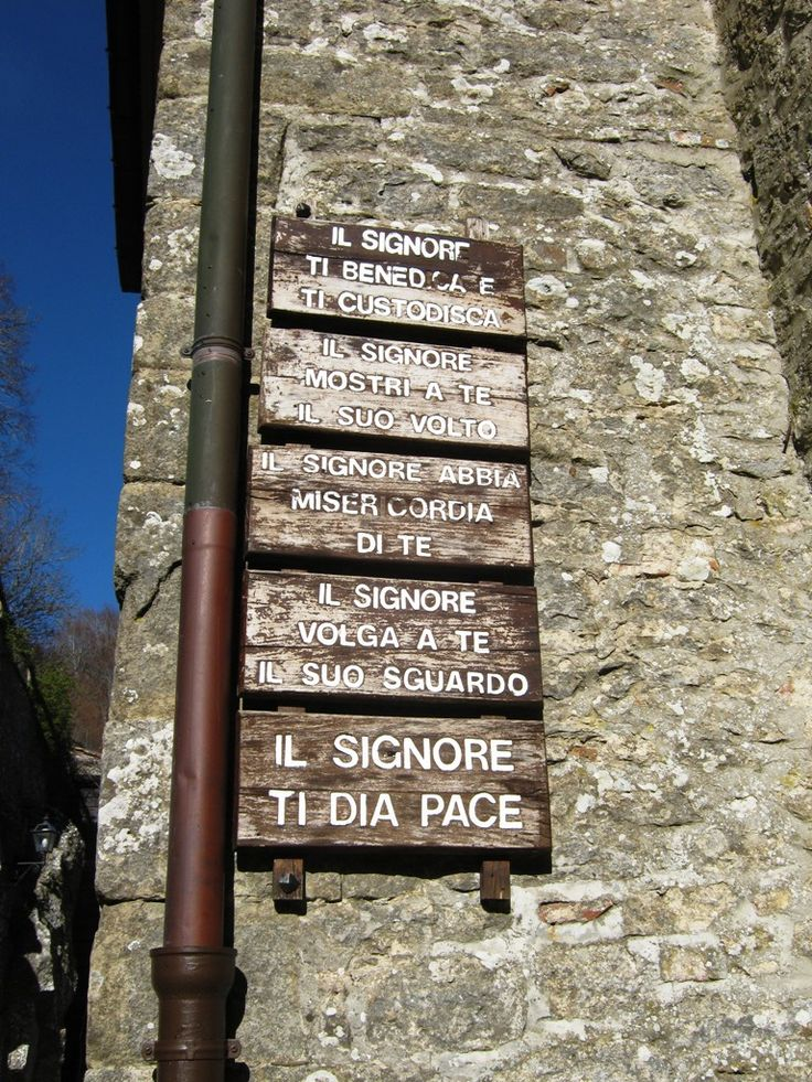 Franciscan mottos at the entrance of La Verna Sanctuary