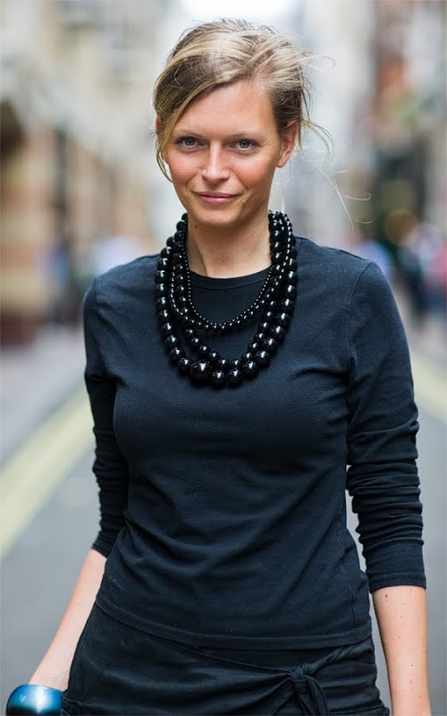 Note: clever way to dress-up casuals. Simple long sleeved black tee glammed up with tonal jewellery...