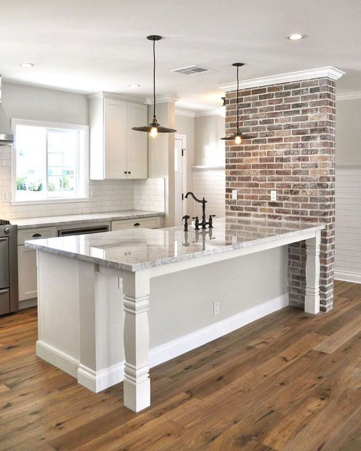 kitchen counter/table/bar // wood floors, subway tile, and brick accent wall