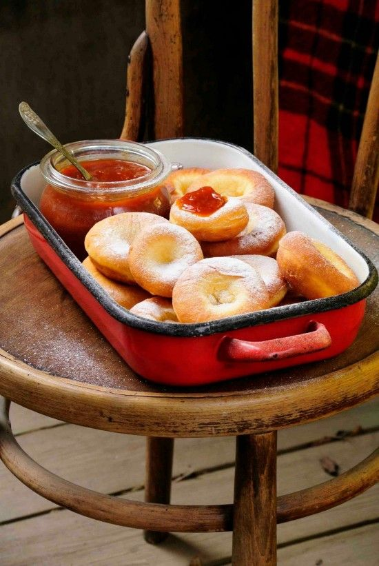 Ribboned Carnival Donuts, traditional Hungarian festive treat, serve with homemade apricot jam and powdered sugar