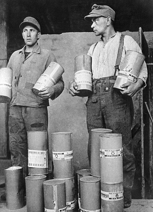 Majdanek death camp. Men holding canisters of the poison gas Zyklon-B at the Majdanek death camp in Poland on 30 July 1944. The camp was liberated by Soviet troops on 23 July 1944, but most of the remaining prisoners had been moved west. The Soviet troops made a documentary film about the camp soon after liberation. As well as the poison gas canisters, large piles of human bones, and hundreds of thousands of shoes were discovered.