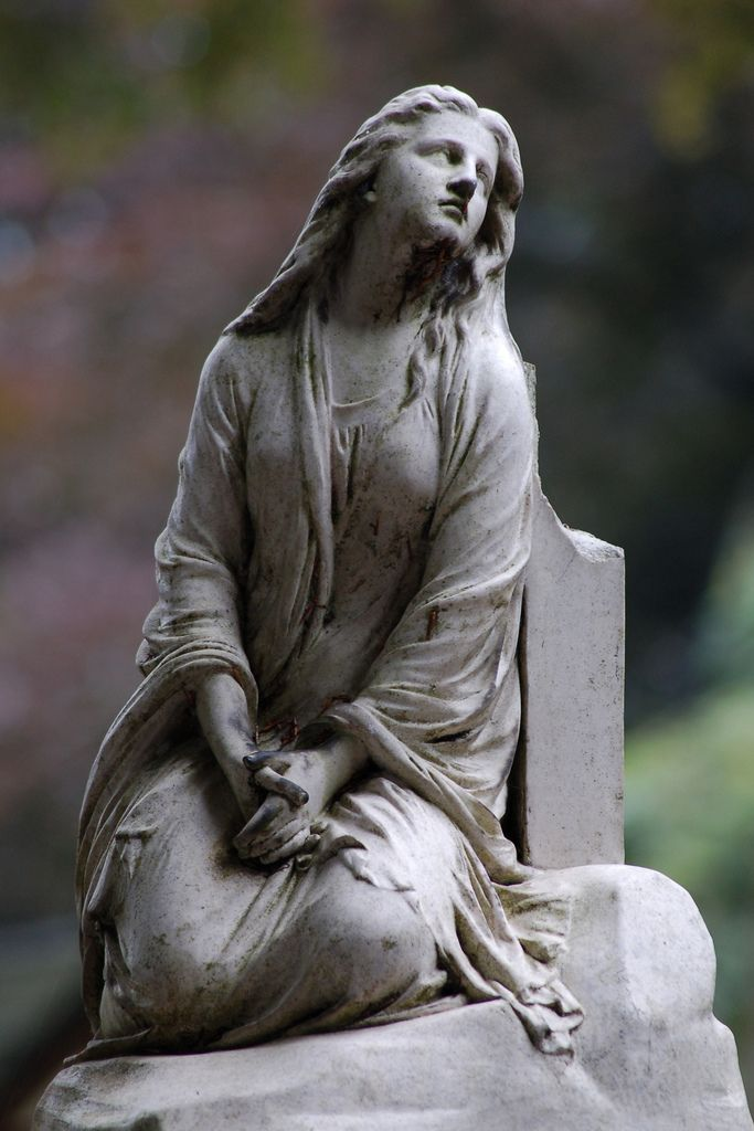 At the Brugge cemetery, Belgium. As she was alive. Once leaning on a huge cross, it's now broken.