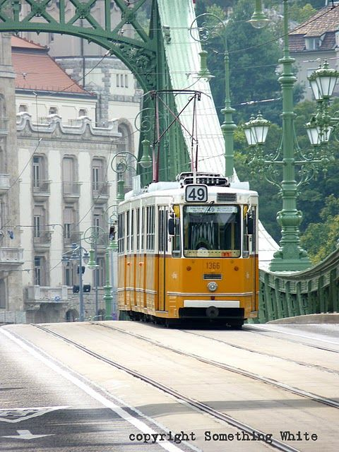 There are 9 bridges crossing the Danube and connecting Buda and Pest. Here, a trolley crosses Liberty Bridge, or Szabadság híd.