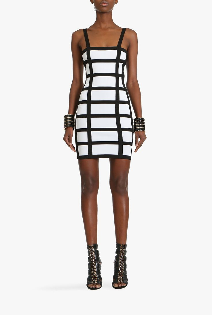 Balmain, Spring-Summer 2015, This black & white dress features cage-effect stripes and is closely cut from figure-skimming stretch viscose knit. Wear yours with a leather biker jacket and sleek sandals.