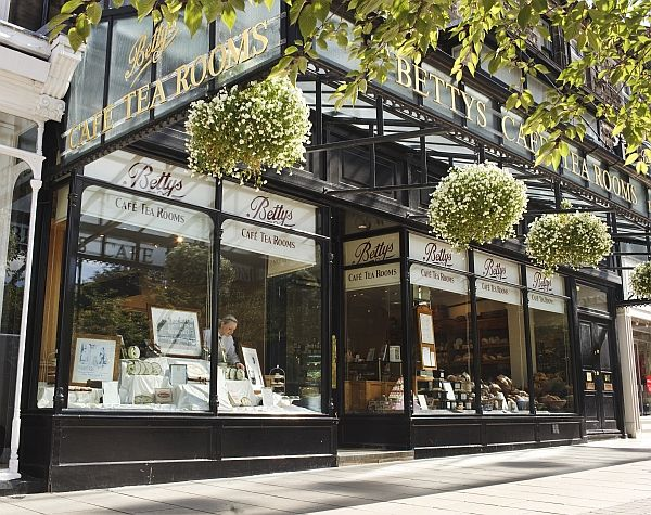 Bettys Ilkley   Bettys Café Tea Rooms on Ilkley's tree-lined Grove is the perfect place to relax. The bright, sunny café tea rooms are lit by windows inset with stained glass Yorkshire flowers and motifs.