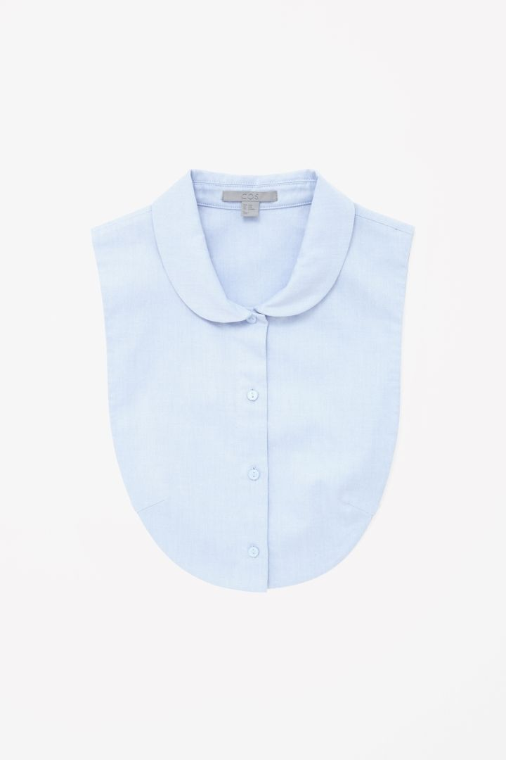 Made from soft cotton twill, this mock shirt is a curved bib shape with a  narrow rounded collar. Designed to be layered under jumpers or tops to give  the ... 39339ba3d1d
