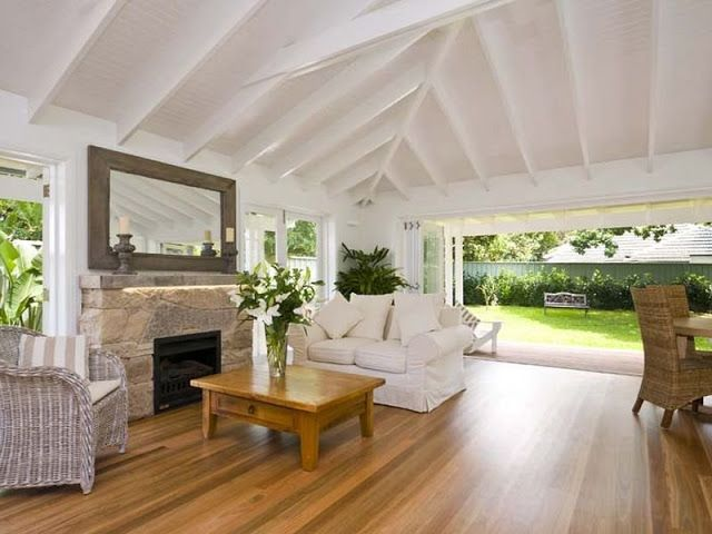 Love the white ceiling, wooden floors, the wood furniture, the bifold/French doors, the sandstone interior