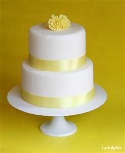 yellow white wedding cake - maybe do purple instead?